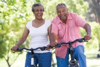 elderly black couple on bicycles.jpg